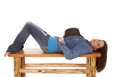 Woman lay on bench hat sleep Royalty Free Stock Images