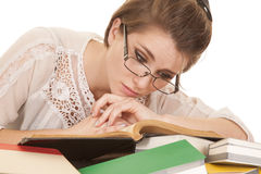 Woman lay on books glass read Royalty Free Stock Photos
