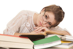 Woman lay on books glasses look over Royalty Free Stock Images