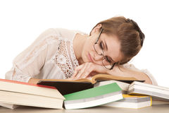 Woman lay on books sleeping Royalty Free Stock Image