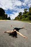 Woman lay down in middle road Stock Photography