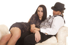 Woman lay on man looking formal Stock Images