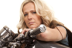 Woman lay on motorcycle tank looking stock photography