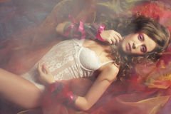 Woman lay on organza. Sleeping beauty. Stock Images