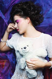 Woman lay on organza with teddy bear Royalty Free Stock Photo