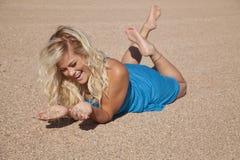Woman lay sand blue play Royalty Free Stock Photos