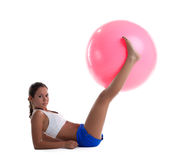 Woman lay and take fitness ball with legs Royalty Free Stock Image