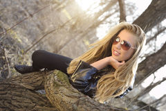 Woman lay on a tree trunk. Beautiful woman lay on a tree trunk royalty free stock photo