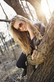 Woman lay on a tree trunk Royalty Free Stock Photos