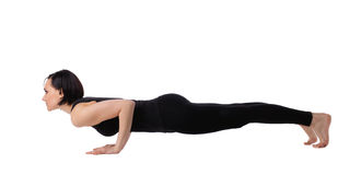 Woman lay in yoga arm balance pose Stock Photo