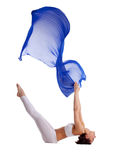 Woman lay in yoga asana with blue fabric isolated Stock Image