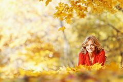 Woman laying on autumn leaves Royalty Free Stock Photos
