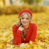 Woman laying on autumn leaves Stock Photo