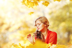 Woman laying on autumn leaves Stock Image