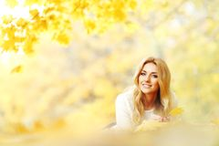 Woman laying on autumn leaves Stock Photography