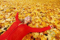 Woman laying on autumn leaves Stock Images