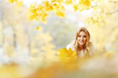 Woman laying in autumn park Royalty Free Stock Photography