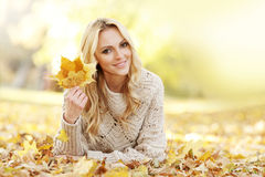 Woman laying in autumn park Royalty Free Stock Photos