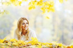 Woman laying in autumn park Royalty Free Stock Images