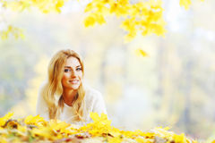 Woman laying in autumn park Stock Photography