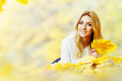 Woman laying in autumn park Stock Images