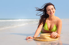 Woman laying on beach Royalty Free Stock Photos