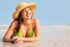Woman laying on beach Stock Photos