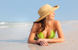 Woman laying on beach Royalty Free Stock Image