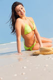 Woman laying on beach Royalty Free Stock Images