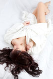 Woman laying on bed Royalty Free Stock Image