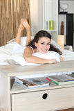 Woman laying in bed. Relaxing Royalty Free Stock Photo