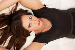 Woman laying on the bed. Stock image of a sexy woman laying on the bed Royalty Free Stock Image