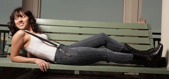 Woman laying on a bench Royalty Free Stock Photography