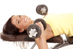 Woman laying bench weights Stock Image