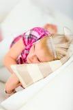Woman laying on divan Stock Image