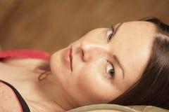 Woman laying down Stock Image