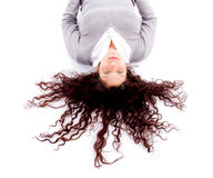 Woman laying down on floor with hair spread out Royalty Free Stock Image