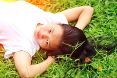 Woman laying down in grass Royalty Free Stock Photos