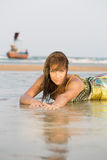 Woman laying down on a sandy beach Royalty Free Stock Photo
