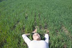 Woman Laying on Field of Green Grass royalty free stock photo