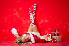 Woman laying on the floor in funny socks Royalty Free Stock Images