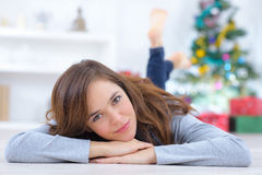 Woman laying on floor at home Royalty Free Stock Photo