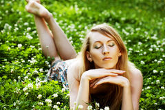 Woman laying on  the grass Royalty Free Stock Photos