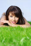 Woman laying on grass Stock Photos