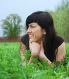 Woman laying on grass Stock Photo