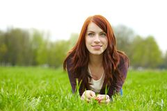 Woman laying on grass Royalty Free Stock Photography