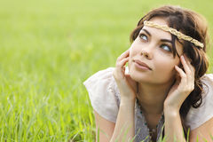 Woman is laying in the grass Stock Photo