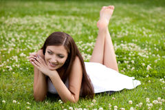 Woman laying on grass Royalty Free Stock Photo