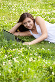 Woman laying on grass Stock Photography