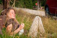 Woman laying on grass Royalty Free Stock Images